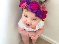 bebe linda con flores